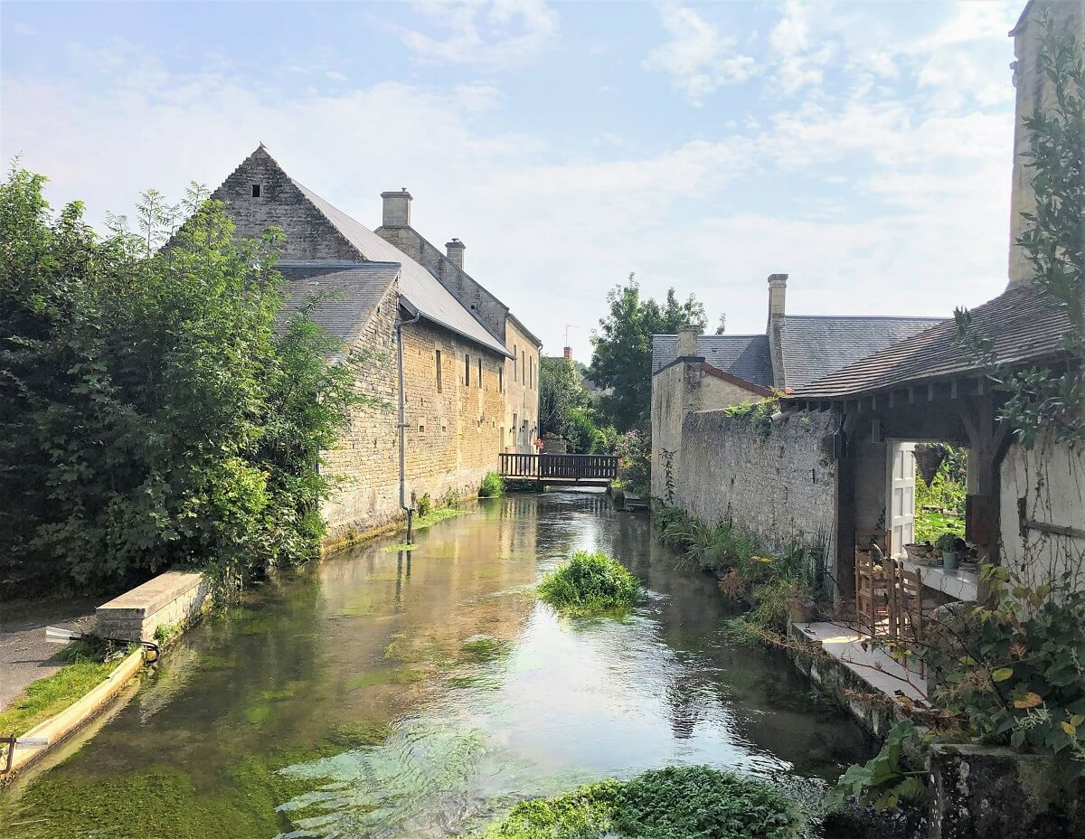 reviers and the river la mue, a charming little village close to the bessin